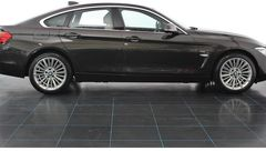 Foto BMW 4 Serie Gran Coupé 440i xDrive 327pk Centennial High Executive | Head-Up | Verwarmd M-Stuur | NL-Auto | Camera | Luxury Line | Leder | Navigatie | Bi-Xenon | Rijklaarprijs! (19801722-3.jpg)