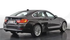 Foto BMW 4 Serie Gran Coupé 440i xDrive 327pk Centennial High Executive | Head-Up | Verwarmd M-Stuur | NL-Auto | Camera | Luxury Line | Leder | Navigatie | Bi-Xenon | Rijklaarprijs! (19801722-4.jpg)